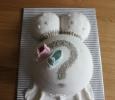 Zwangere buik taart met babyschoentjes